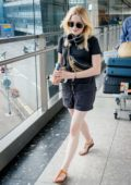 Ellie Bamber keeps it casual yet trendy as she arrives at Heathrow Airport in London, UK