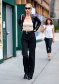 Elsa Hosk looks sharp in a black blazer paired with a crop top and black trousers as she steps out in SoHo, New York City