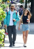 Emily Ratajkowski and Sebastian Bear-McClard take their dog to a local dog park in New York City