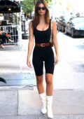 Emily Ratajkowski looks great in a black bodysuit paired with white boots while out for a stroll in New York City
