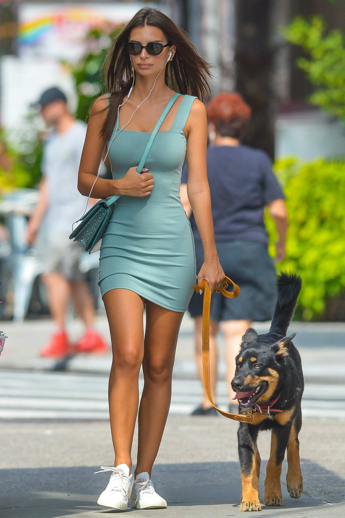 Emily Ratajkowski looks great in a blue mini dress and white sneakers while out with her dog in New York City