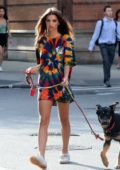 Emily Ratajkowski looks great in an oversized colorful t-shirt while out with her dog in New York City