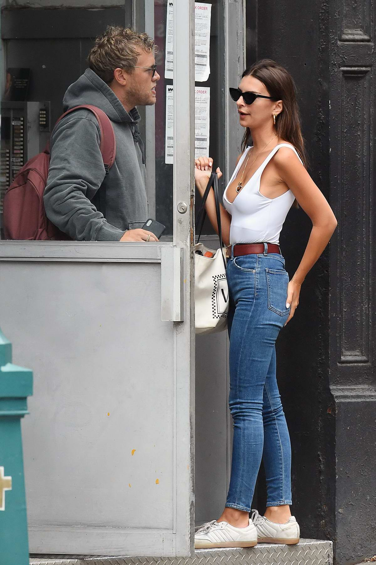 Emily Ratajkowski rocks a white tank top and jeans as steps out with Sebastian Bear-McClard in New York City