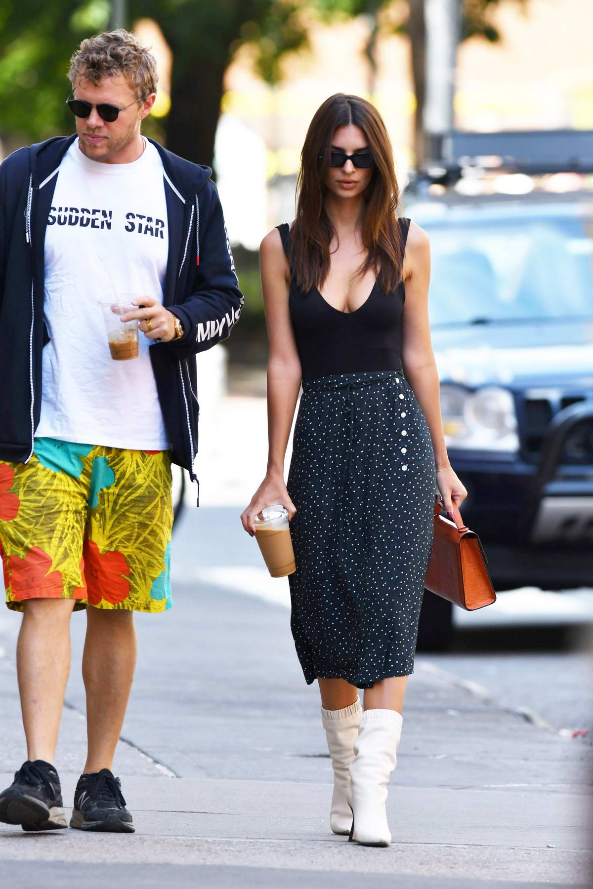 Emily Ratajkowski wore a black top with polka dot skirt and white boots as she stepped out for coffee with Sebastian Bear-McClard in New York City