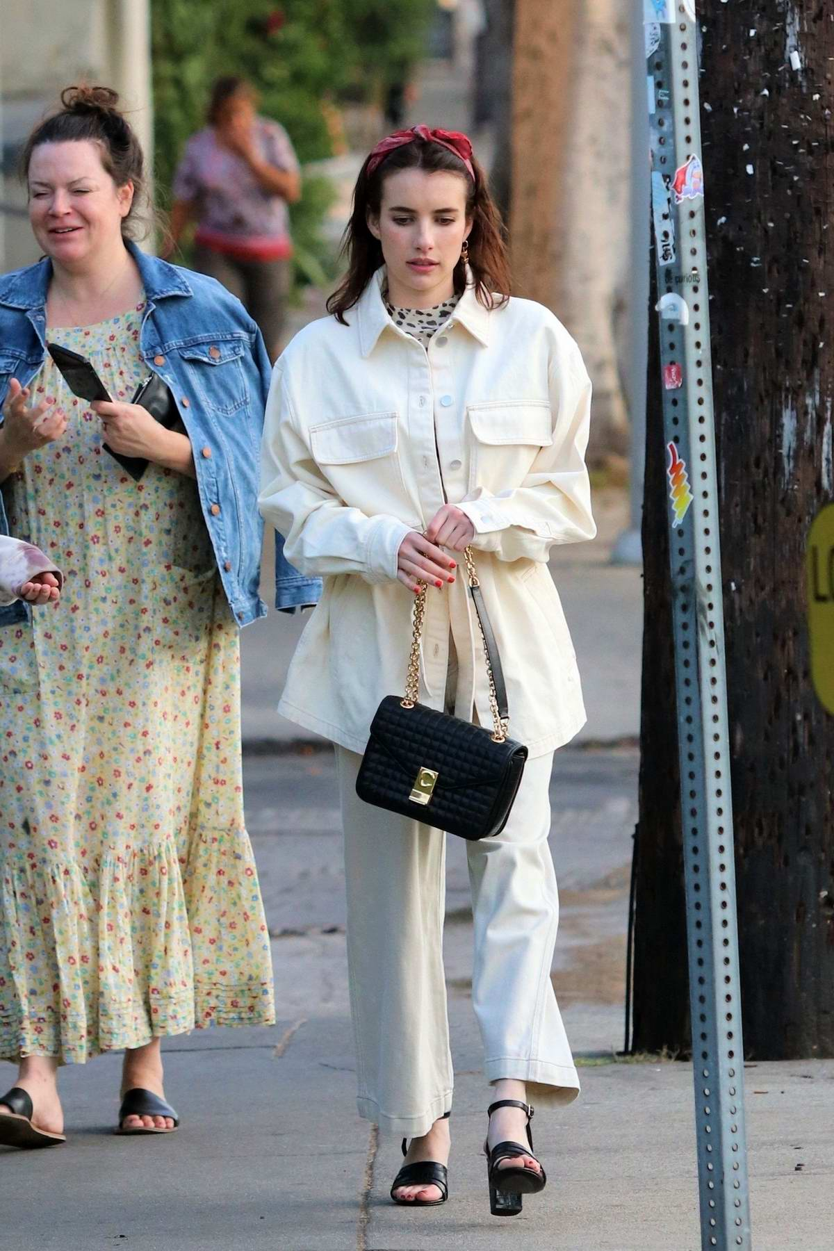 Emma Roberts looks stylish in white ensemble while out for dinner with a friend in Los Feliz, California