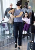 Emmy Rossum has her diet Sprite explode in her hands upon arrival at JFK airport in New York City