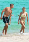Eugenie Bouchard wears a light green bikini while enjoying a beach date with new beau Connor Davis in Miami, Florida