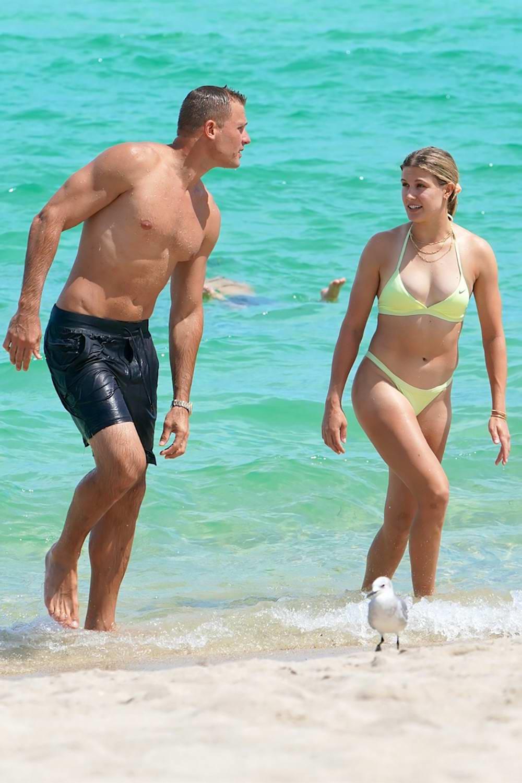 Eugenie Bouchard wears a light green bikini while enjoying a beach date with new beau Connor Davis in Miami, Florida