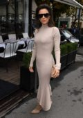 Eva Longoria wears a beige bodycon dress as she arrives at L'Avenue restaurant in Paris, France
