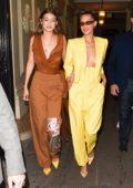 Gigi and Bella Hadid attend 'The Americans in Paris' event during Paris Fashion Week in Paris, France