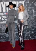 Gigi Hadid and Bella Hadid attend the Tommy x Zendaya Show at The Apollo Theater in New York City