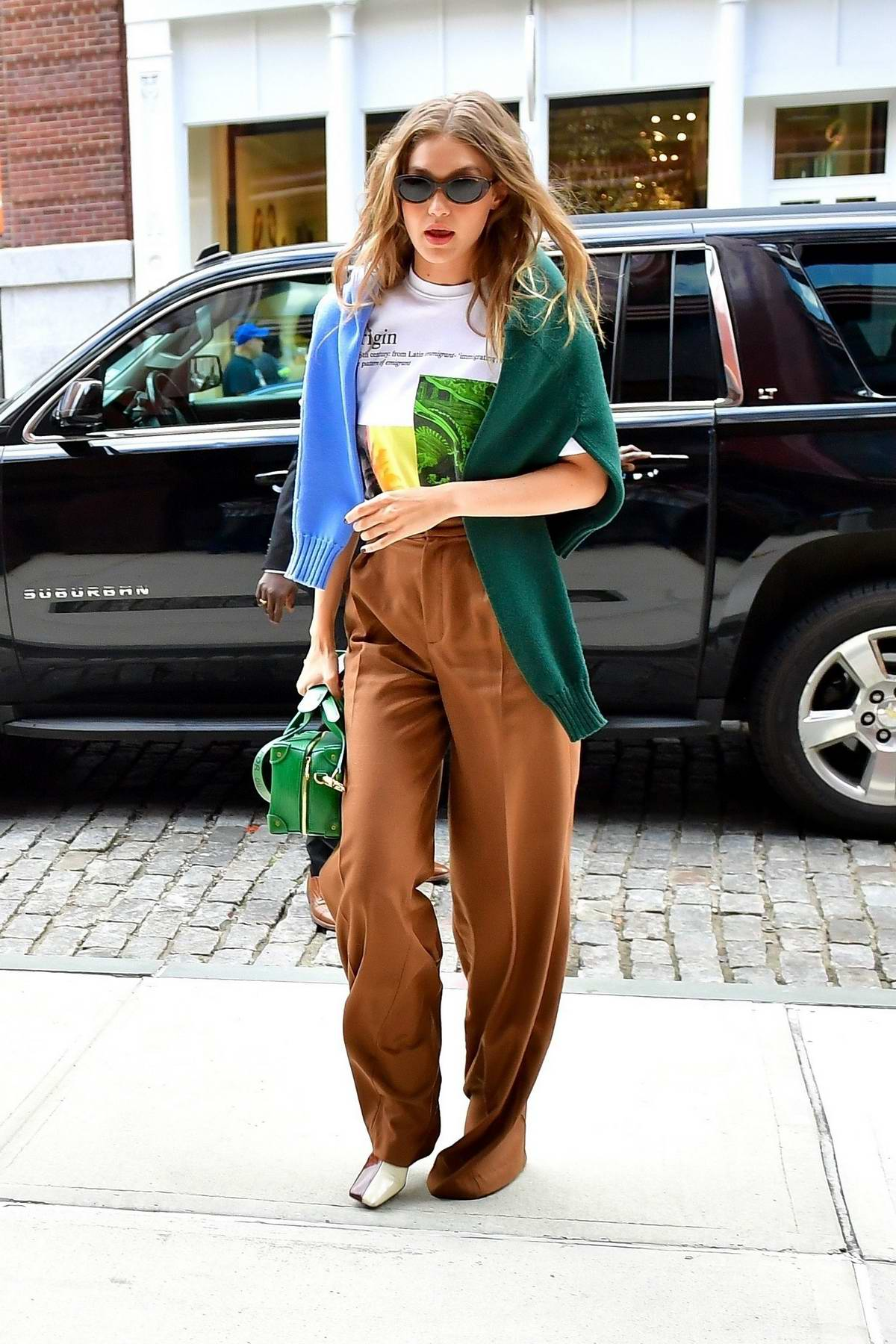 Gigi Hadid heads out for lunch in a color-blocked outfit in New York City