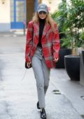 Gigi Hadid rocks a plaid blazer while out and about in Paris, France