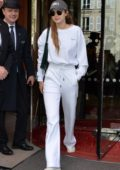 Gigi Hadid rocks all white while seen outside her hotel during Paris Fashion Week in Paris, France