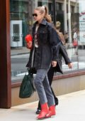 Gigi Hadid rocks double denim and red cowgirl boots while out in New York City