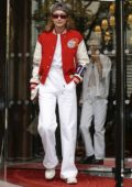 Gigi Hadid rocks red and white jacket with an all white ensemble as she heads out during PFW in Paris, France