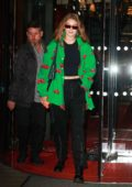 Gigi Hadid wears a bright green jacket as she leaves Royal Monceau hotel during PFW in Paris, France