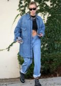 Hailey Baldwin flaunts her abs in a black crop top paired with double denim as she steps out in Beverly Hills, Los Angeles