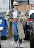 Hailey Baldwin looks stylish in a crop top and trench coat while visiting Manavi Healing Center in Los Angeles