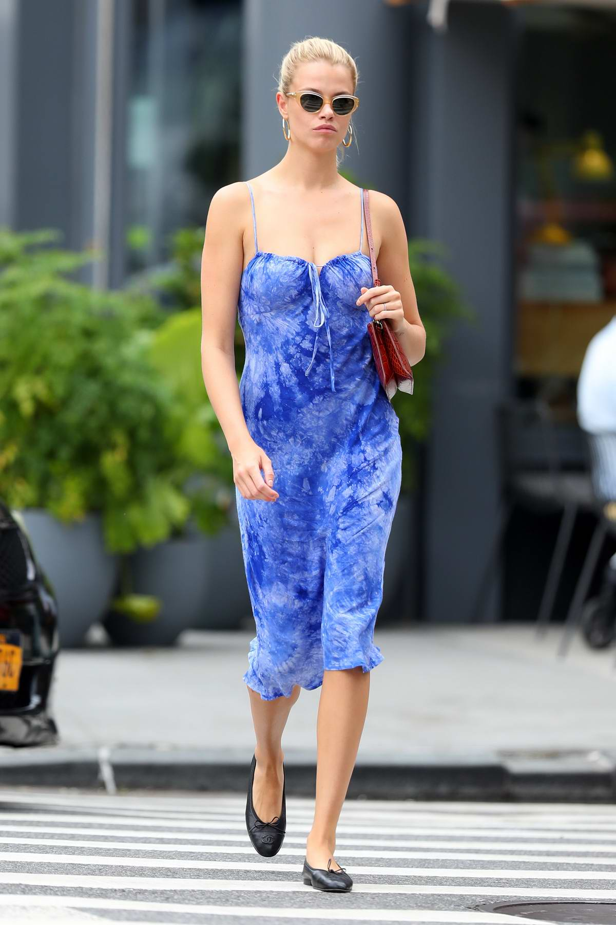Hailey Clauson steps out wearing a blue dress in New York City