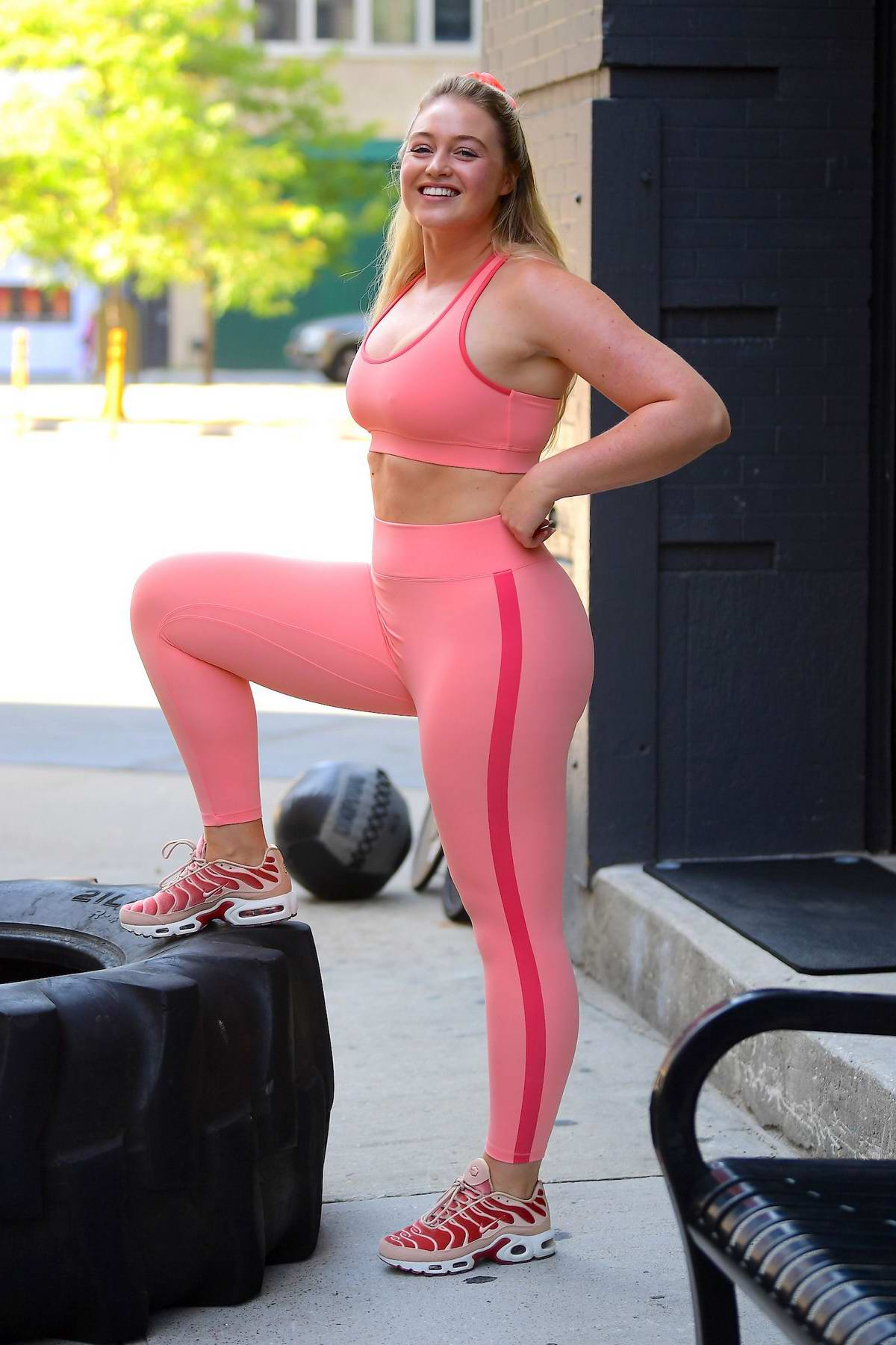 Iskra Lawrence looks great in a pink crop top and matching leggings during a workout session at Dogpound gym in New York City