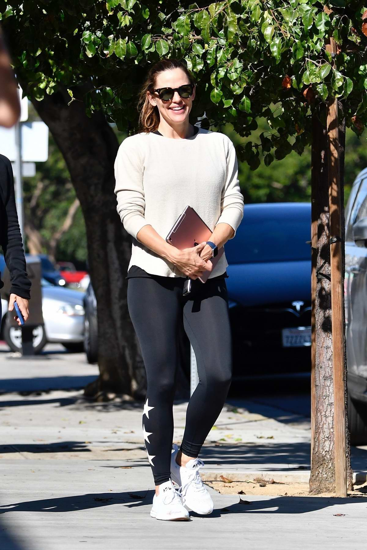 Jennifer Garner seen wearing an off-white sweatshirt and black leggings while out for a meeting in Beverly Hills, Los Angeles