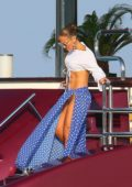 Jennifer Lopez flashes her toned abs as she arrives for Magic Johnson's 60th birthday at Nikki Beach in Saint Tropez, France