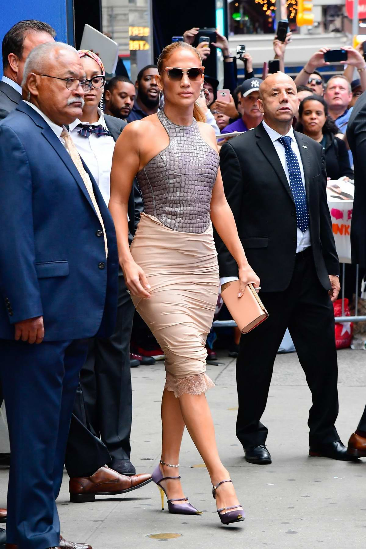 Jennifer Lopez looks great in a skin-tight leather top and beige skirt as she leaves 'Good Morning America' in New York City