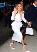 Jennifer Lopez looks stunning in a white dress as she arrives to Ultra Beauty for a perfume launch party in New York City