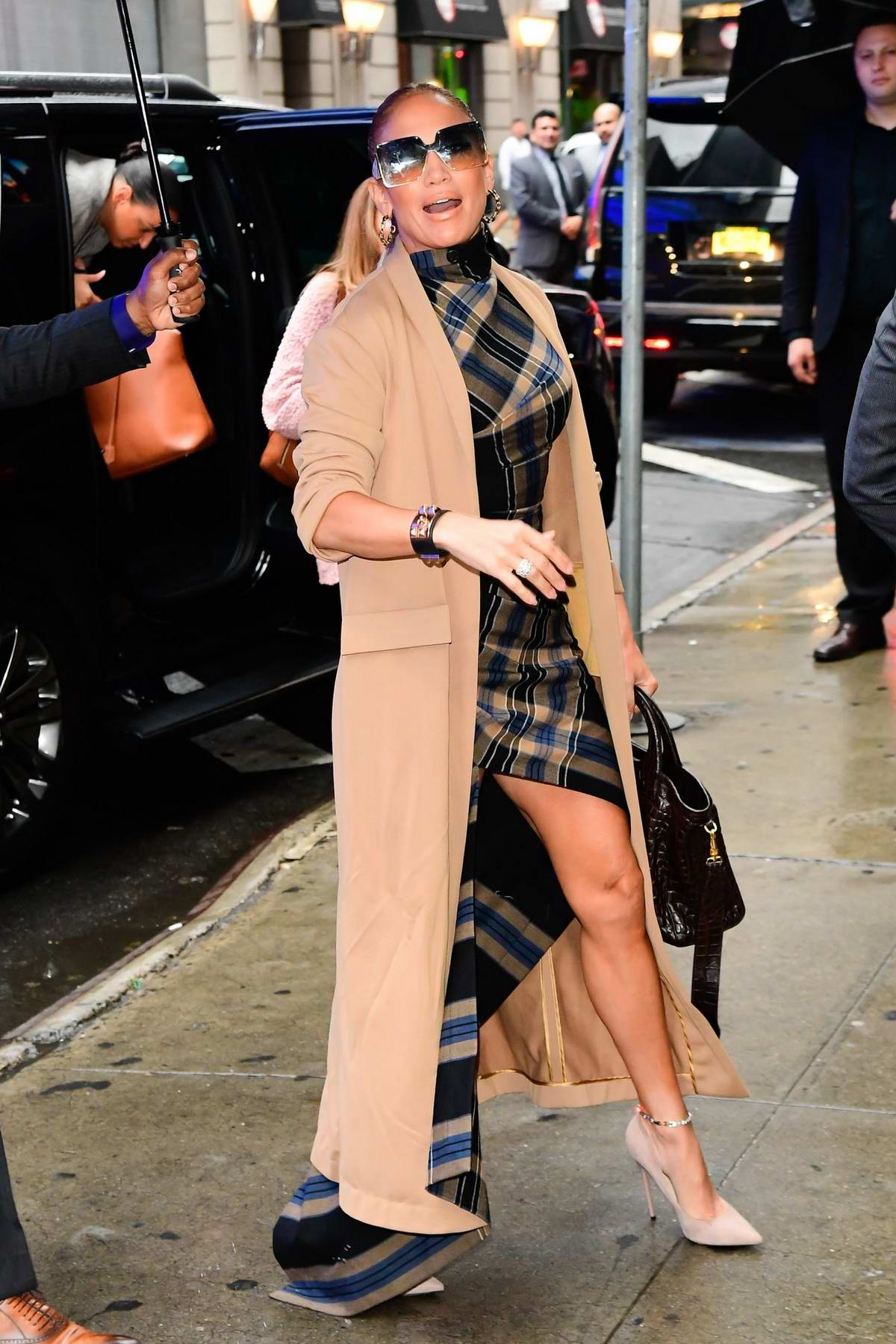 Jennifer Lopez wears plaid dress with a beige trench coat as she arrives at 'Good Morning America' in New York City