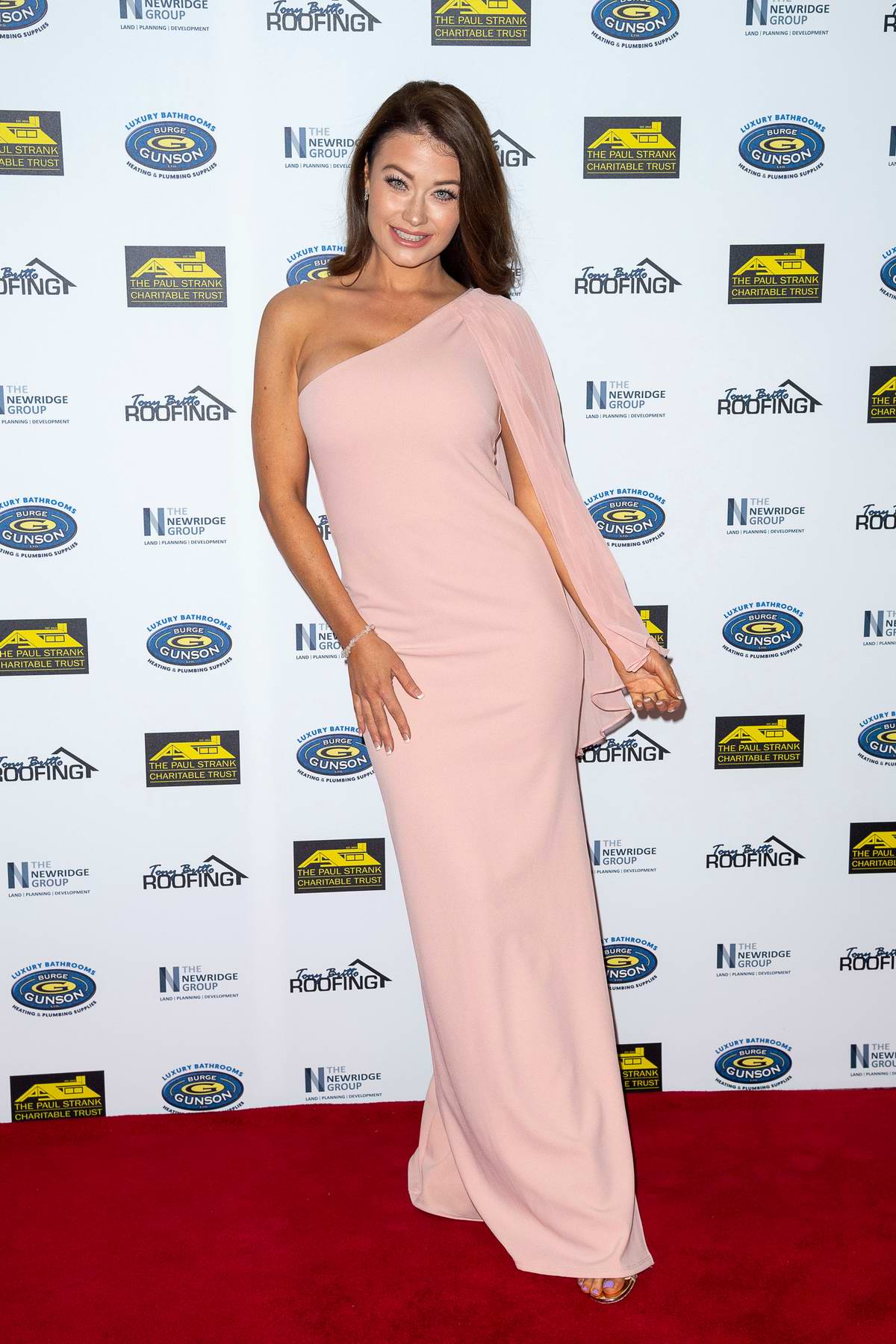 Jess Impiazzi attends The Paul Strank Charity Gala at Bank of England Sports Centre in London, UK