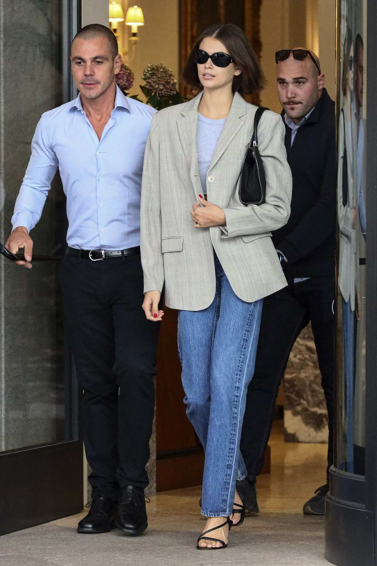 Kaia Gerber looks stylish in blazer and jeans as she leaves the hotel during Milan Fashion Week in Milan, Italy