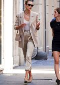 Karlie Kloss looks chic in a beige pantsuit as she steps out for stroll in Rome, Italy