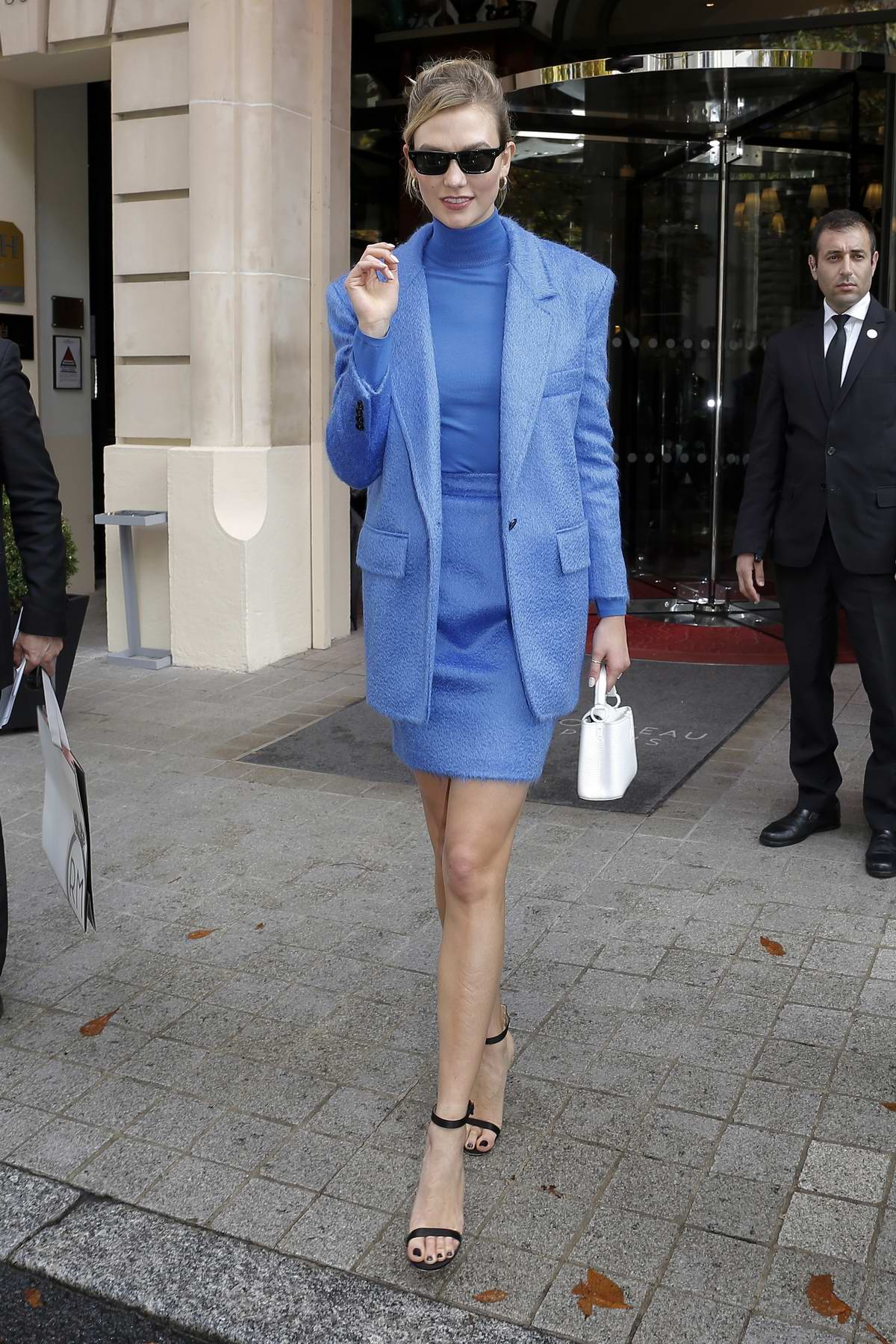 Karlie Kloss looks great in a blue skirt suit as she leaves Royal Monceau hotel during Paris Fashion Week in Paris, France