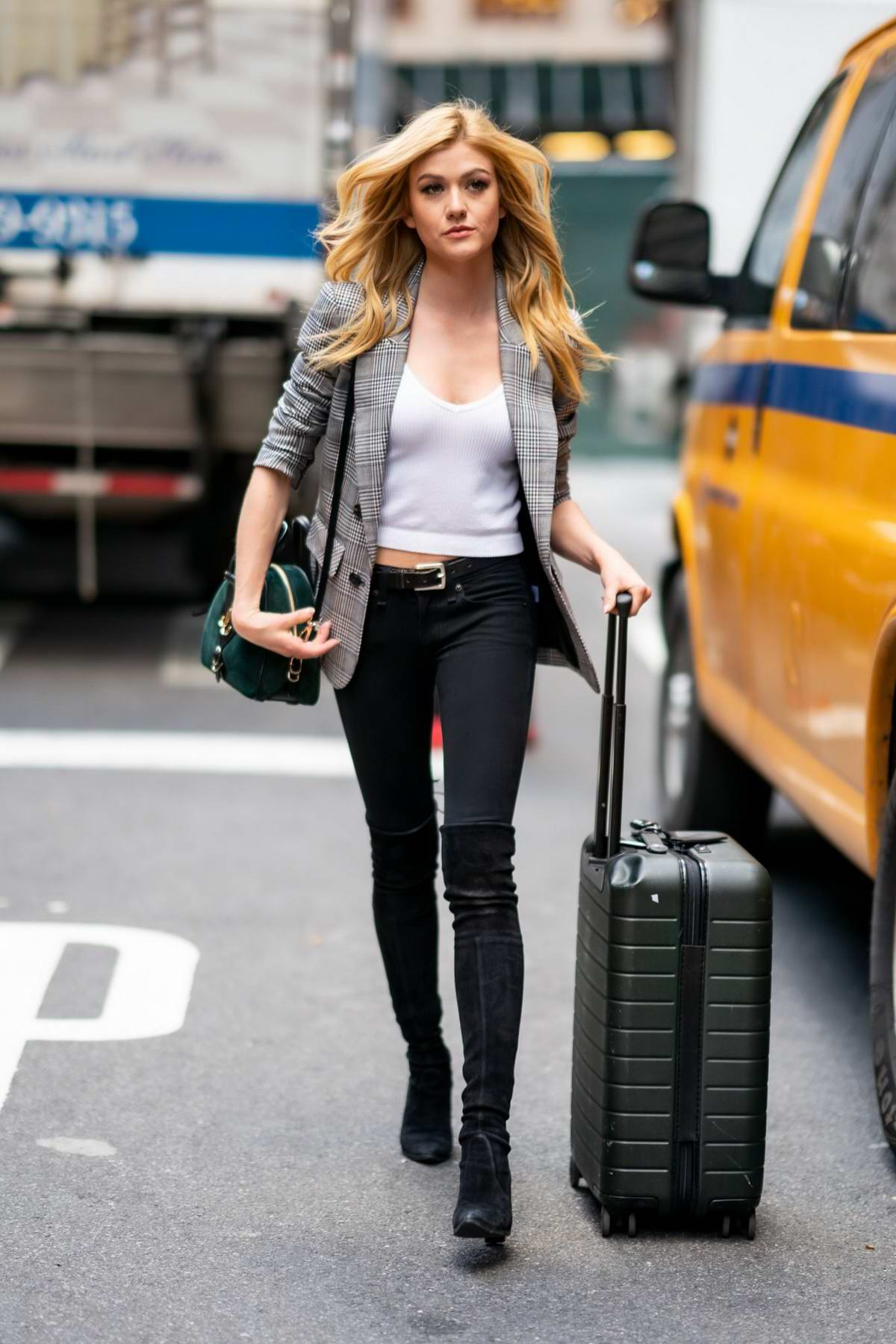 Katherine McNamara looks chic while out with a suitcase in Midtown, New York City