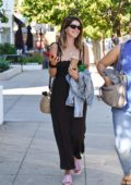 Katherine Schwarzenegger is all smiles as she steps out for coffee with a friend in Beverly Hills, Los Angeles