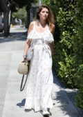 Katherine Schwarzenegger looks lovely in a white summer dress as she leaves a hair salon in Los Angeles