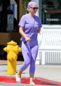 Katy Perry wears a lavender top with matching leggings and slides as she steps out to run a few errands in Los Angeles