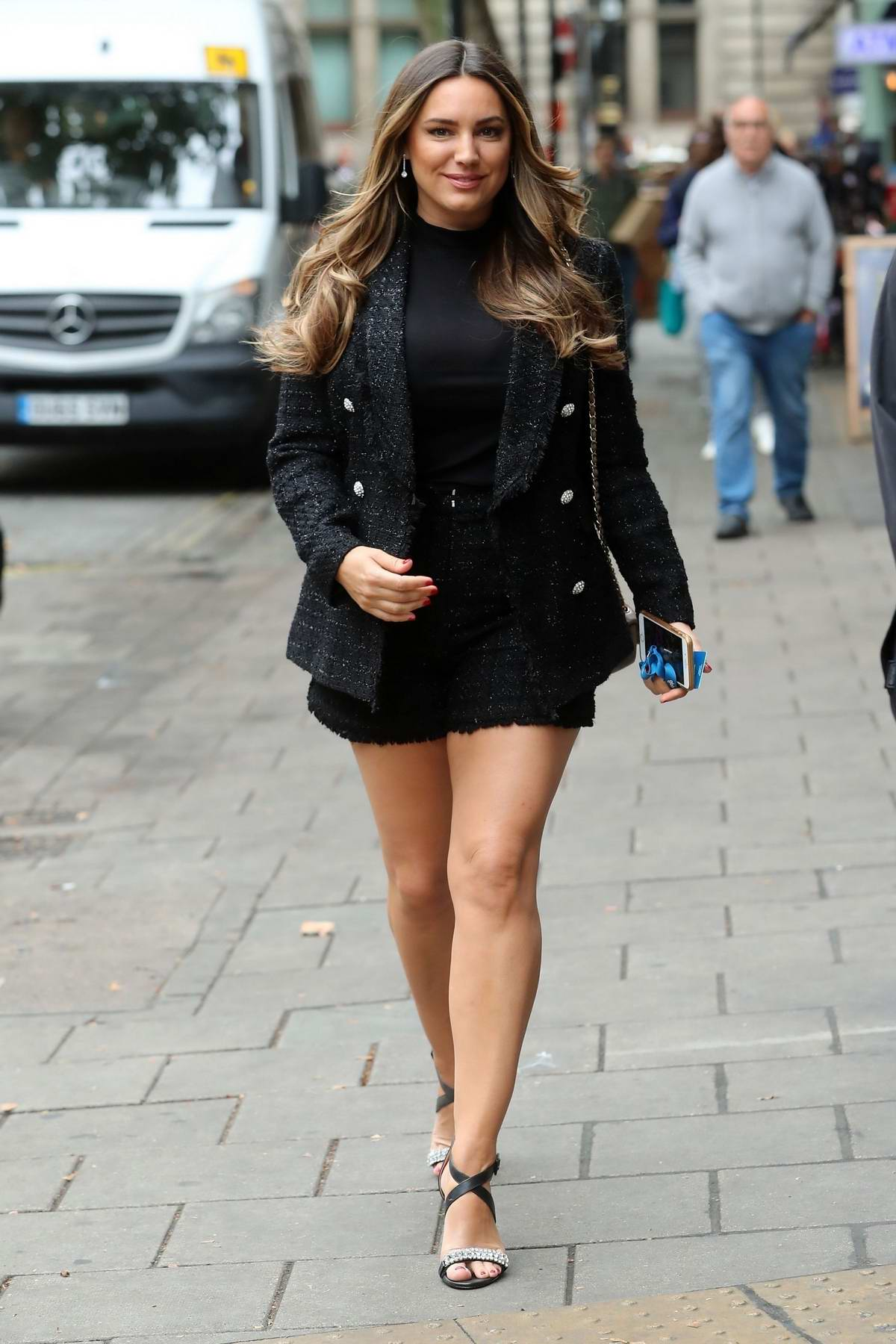 Kelly Brook looks stunning in a black tweed blazer with matching shorts as she arrives at Global Radio in London, UK