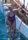 Kelly Brook wears a colorful floral swimsuit on a White Goose Luxury Gulet while on vacation in Bodrum, Turkey