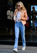 Kendall Jenner looks cool in a tan leather jacket as she steps out during Milan Fashion Week in Milan, Italy