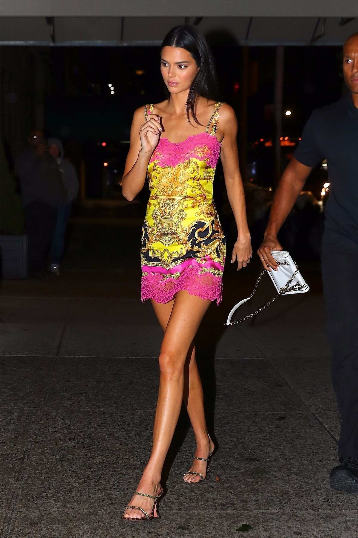 Kendall Jenner looks striking in a Versace dress while out for dinner with friends in New York City
