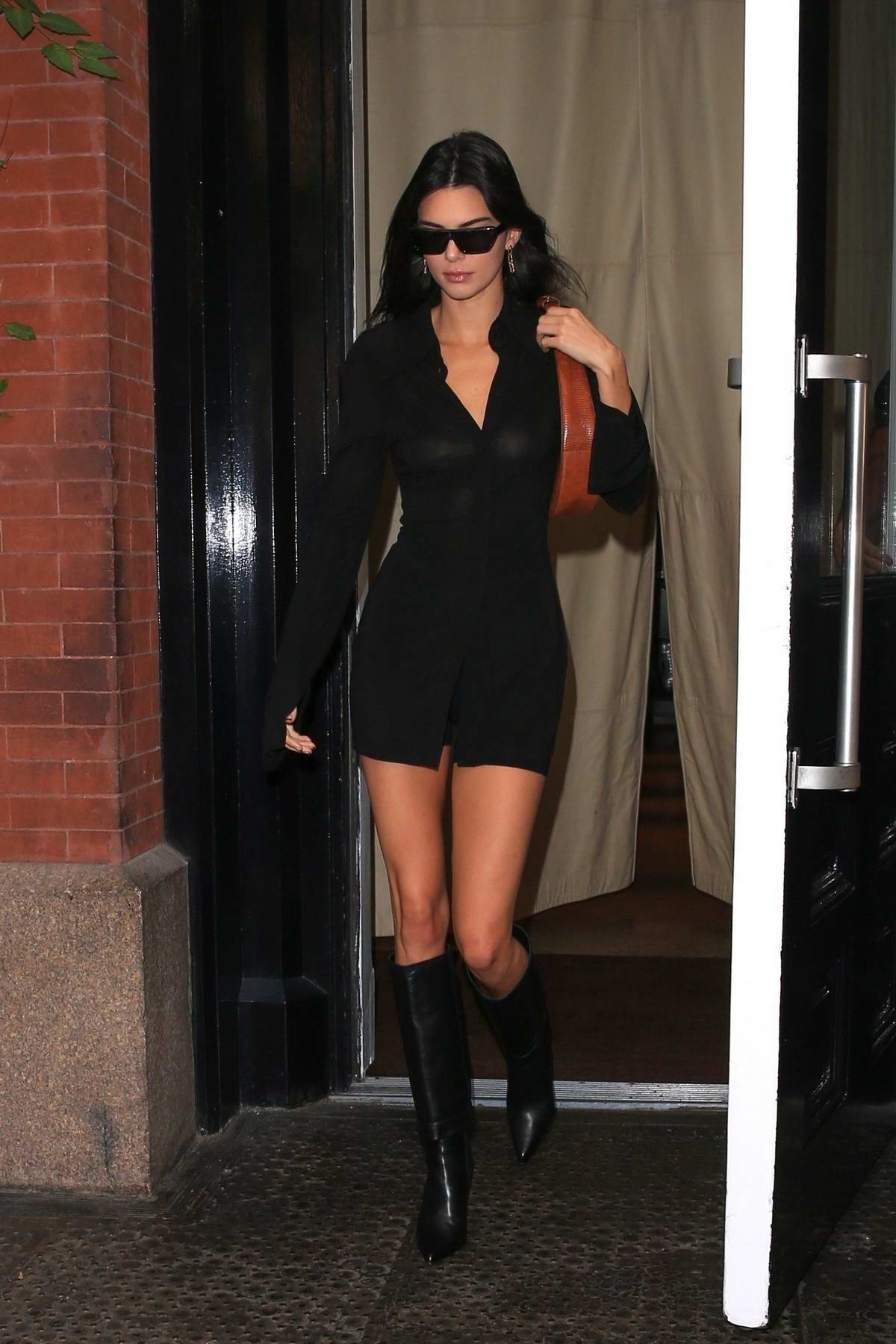 Kendall Jenner looks stunning in a short black dress as she leaves the Mercer Hotel in New York City