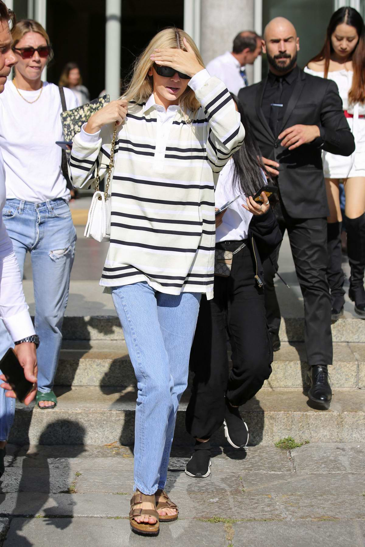 Kendall Jenner steps out donning stripes during Milan Fashion Week in Milan, Italy