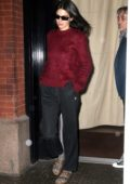 Kendall Jenner wears a fuzzy maroon sweater and black Adidas pants as she leaves the Mercer Hotel in New York City