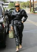 Khloe Kardashian dons black leather jumpsuit for lunch at Plata Taqueria & Cantina in Agoura Hills, California