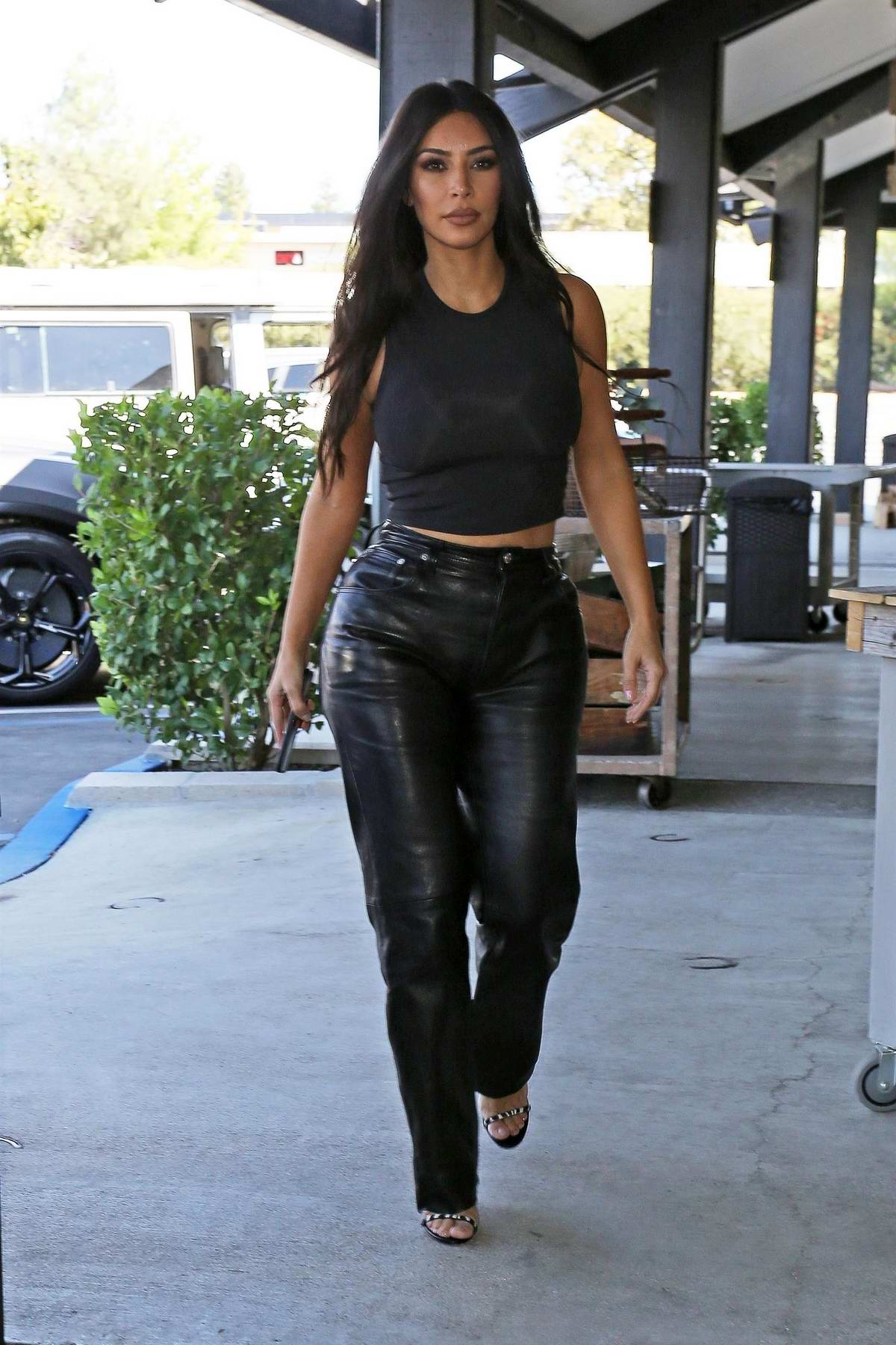 Kim Kardashian dons all black as she steps out for lunch in Los Angeles