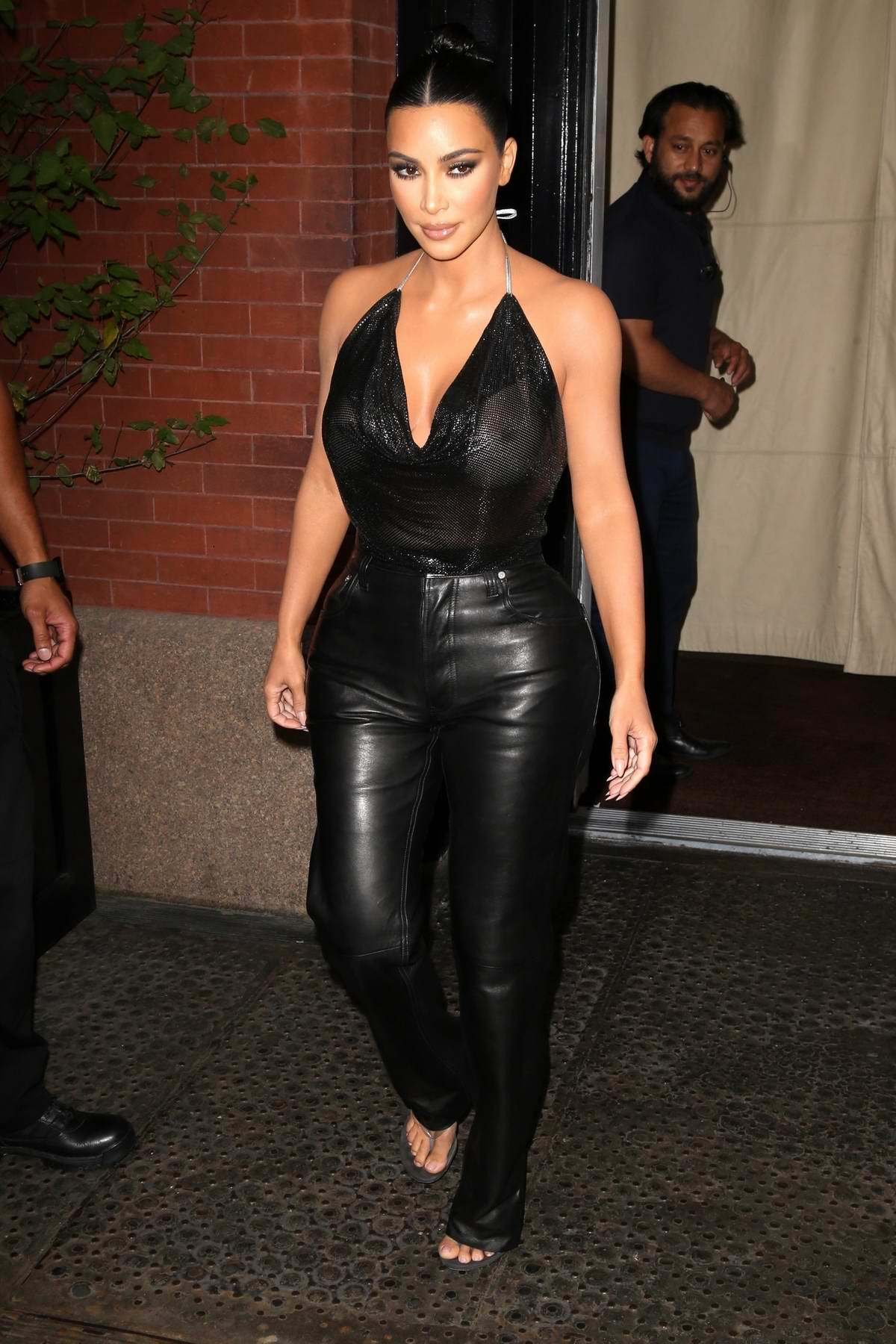 Kim Kardashian rocks a sheer top and black leather pants as she heads to the 'Tonight Show with Jimmy Fallon' in New York City
