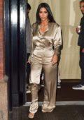 Kim Kardashian shines in a beige satin ensemble as she leaves The Mercer Hotel in New York City