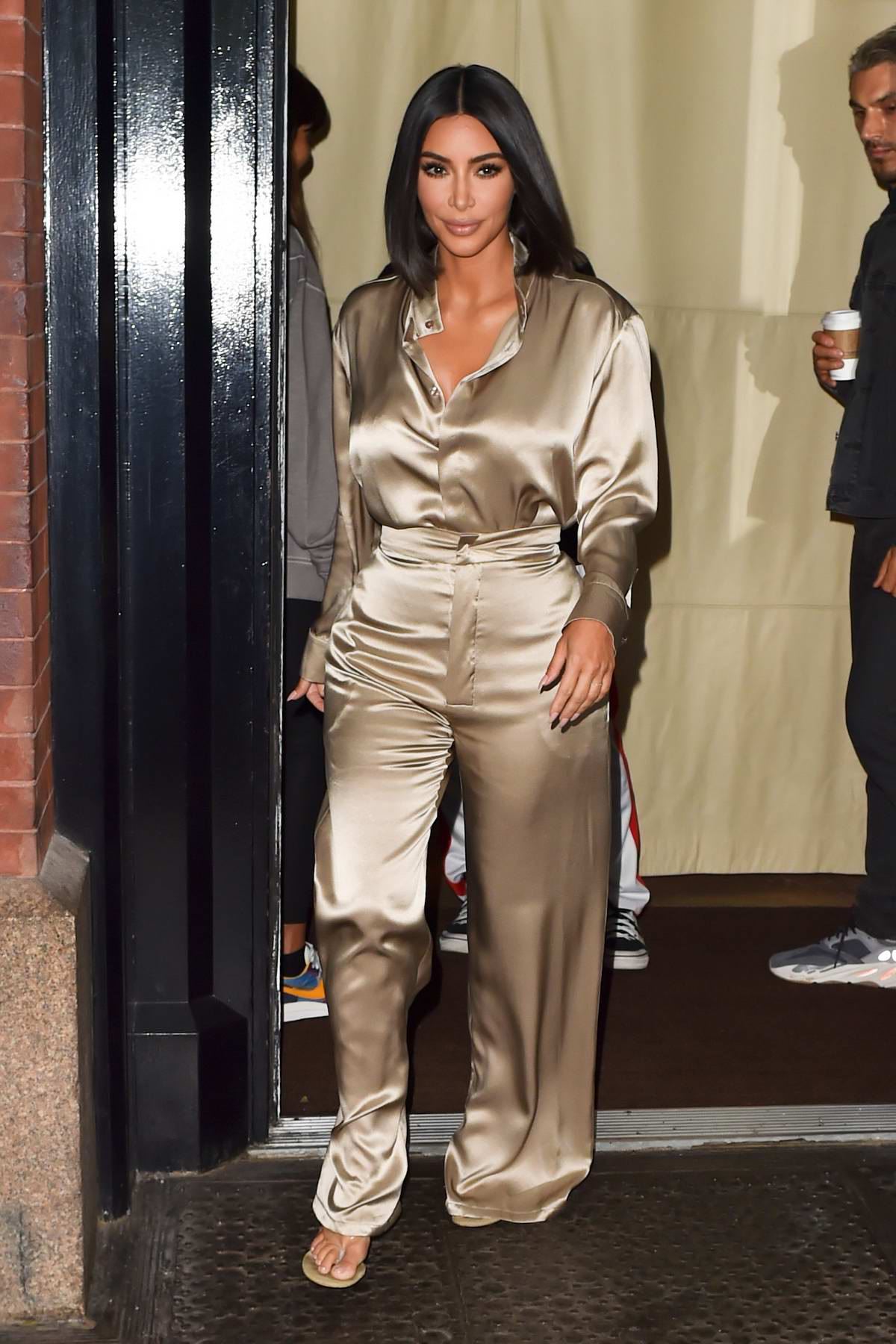 Kim Kardashian shines in a beige satin ensemble as she leaves The Mercer Hotel in New York City